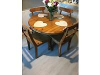 Small extendable dining table and 4 chairs