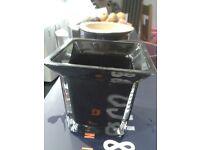 Small black glass plant pot
