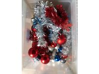 Big box of baubles, tinsel and other decorations