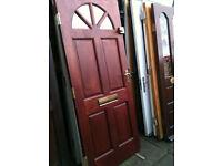 Exterior hardwood door with smoked half-circle glass