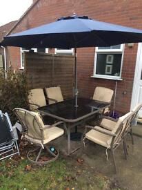 Patio table and chair and umbrella
