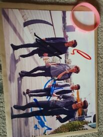 Signed union j photo and wrist band