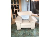 Cream leather armchair with footstool