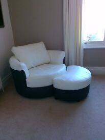 Twister armchair and footstool, cream leather, perfect, unused. Bargain £250.