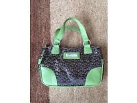 Gracie Mae brown patterned bag with green leather trim.