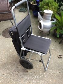 Shopping trolley with fold out seat
