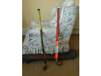2 wooden hockey sticks and bag