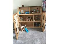 Wooden dolls house with furniture and 6 figures