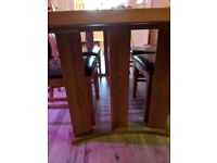 6 seater solid oak dining table and chairs