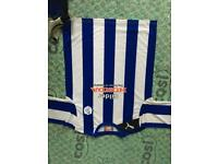 Various Sheffield Wednesday shirts for sale