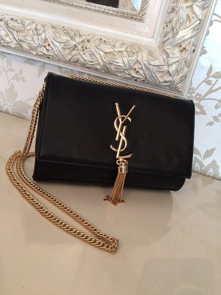 ysl bag ysl clutch bag saint laurent bag saint laurent clutch bag designer clutch bag designer bagin Ilford, LondonGumtree - Ysl bag in Black with gold tassle detail. Brand new with tags, labels and dustbag. adjustable strap. Can be used as a clutch bag and side bag