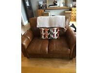 Real leather two seater sofa in tan , damage in top corner, ( unseen)