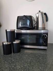 Black and silver Microwave, toaster, kettle and tea and coffee jars