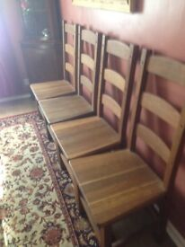 Four Oak Ladder Back Chairs