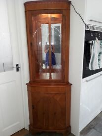 Corner Display Cupboard. Excellent Condition. Made in 1980's or 1990's. Cupboard has 2 shelves.