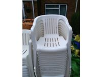 Used white plastic chairs