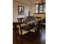 Dark wood extending table with 8 chairs
