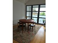 Danish vintage Dining table + 4 Chairs.