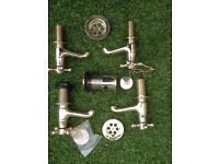 Brand new, 2 pairs of gold effect (kitchen or bathroom) taps