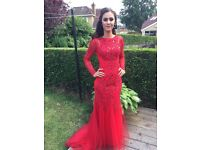 Red fitted mermaid style prom dress