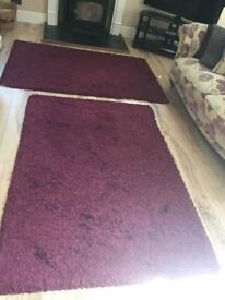 One large purple rug for sale