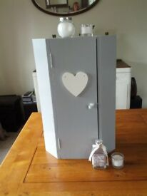 grey corner cupboard with white heart detail and interior shelves. Lovely condition