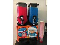 Slush Machine Eskimo joe less than 1 year old. Includes 700 large & 700 small cups & straws & syrups