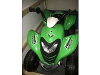 Kids electric quad bike, black and green, in good condition, selling for more room