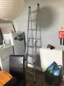 Tall metal ladder