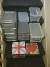 Various small plastic storage boxes and stack shelves