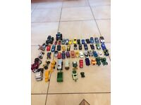 Various toy cars, tractors, motorbikes and trains