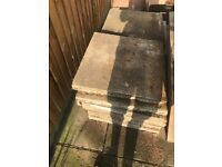Whole paving slabs, some square some rectangular.