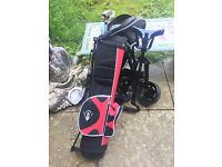Junior set of golf clubs with stand