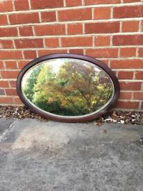 Vintage mahogany oval mirror.