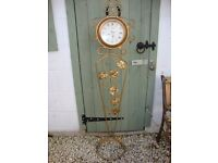 Wrought Metal Julianna Clock,on stand or can be wall mounted.