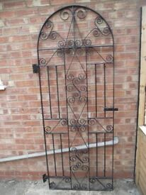 wrought iron bow top gate.