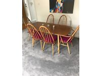 Ercol dining room table and six chairs with cushions