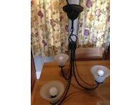 black elegant three arm ceiling light and two matching wall lights