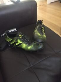 Size 11, Black and yellow football boots, RRP £150