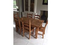 Dining table and 6 chairs with matching dresser Mexican pine.