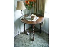 Circular oak table with additional glass cover