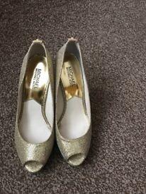 Michael Kors gold heels