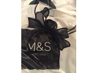 Black fascinator never been worn marks and spensers