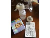 Nuby breast pump and lansinoh milk storage bags