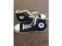 Black Converse All Stars on a size 2
