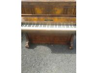 Upright piano. Needs tuning hence price for quick sale