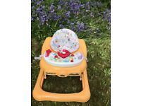 Baby Walker with music. In good condition and all washable. Inc feeding tray