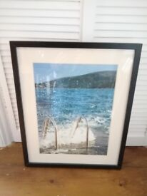 2 Large Photographs in Black Picture Frames