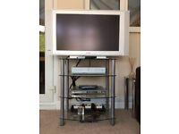 Glass 4 shelf unit. SHELF UNIT ONLY DOES NOT INCLUDE TV, SKY ETC.