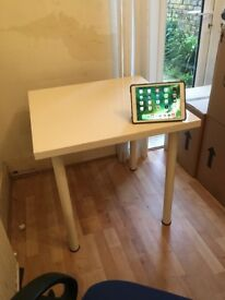 2 attractive white tables . Legs screw on and off . Free , but hurry